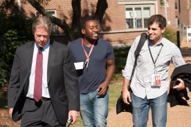 Arden Farhi walks around campus with Major Garrett and another member of the media during the second 2016 presidential debate.