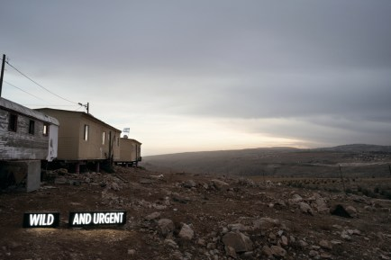 "Shimon Attie, ""WILD AND URGENT."" Two on-location light boxes, Settler Houses, Israeli Settlement, West Bank, 2014, digital c-print / Courtesy of the artist and Jack Shainman Gallery, New York."