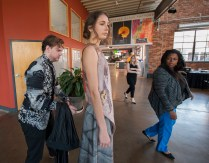 From left: Designer Maximillian Suiter preps Sienna Feher of CENTRO Models for a photo shoot as fashion design faculty Claire Thomas-Morgan and Jennifer Ingram look on. (Photo: Joe Angeles/Washington University)