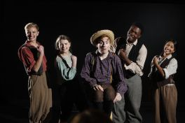 """From left to right: Brandon Krisko, Carly Rosenbaum, Zack Schultz, Dwayne McCowan III and Nina Punyamurthy rehearse Carter W. Lewis' """"Tom Sawyer Whitewashes a Fence"""" in Mallinckrodt Center. Commissioned by the School of Law, the 20-minute play received its world premiere March 15 at the Four Seasons Hotel in Washington. (Photo: Jerry Naunheim Jr./Washington University)"""