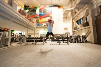 """Staff member Seth Alms works out at Sumers every morning before work. He calls Bryan Lenz, director of recreational sports and campus fitness, and his staff """"family."""" Lenz calls Alms the university's """"American Ninja Warrior."""" (Joe Angeles/Washington University)"""