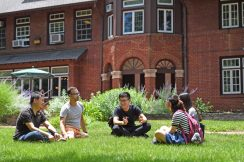 students on lawn outside Stix House