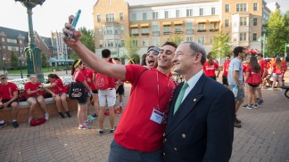 But first, a selfie. Chancellor Wrighton poses with students during Move-in Day in 2016.
