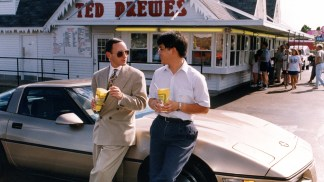 Then-graduate student Hubert Chuang with Chancellor Mark S. Wrighton at frozen custard stand Ted Drewes. Chuang was one of two students who won a raffle at the time of the 1996 inauguration to accompany the Chancellor in his 1984 bronze Corvette on a visit to the St. Louis landmark.