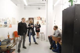 From left: David Polzin, Heather Polzin and Suzann Fulbright talk with Elliot Head, a master's candidate in the Sam Fox School of Design & Visual Arts, during the MFA Open Studios Jan. 27. Sponsored by Women and the Kemper, the annual event offers a behind-the-scenes look at works from emerging artists in painting, printmaking, photography, sculpture, combined media, installation and video. (Photo: Jerry Naunheim Jr./Washington University)