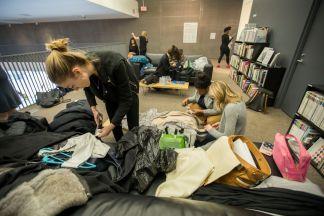 Senior designer Karalena Davis makes final preparations as she waits her turn for a model. (Photo: Joe Angeles/Washington University)