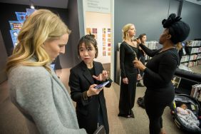 From left: Seniors Adria Duncan and Sherry Yunhui Xu discuss makeup options as Soleil Richardson's makeup gets a touch-up from Randi Nicole. (Photo: Joe Angeles/Washington University)