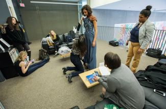 Senior Haley Lundberg (in striped sweater) prepares model Michaela Bartley. (Photo: Joe Angeles/Washington University)