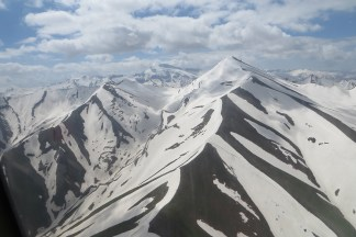 A view during a helicopter ride to a hike in the Pamir Mountains.