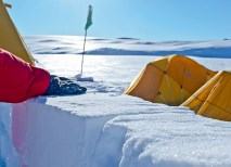 All personnel going off station in Antarctica must complete a field safety course called Snowcraft, or Happy Camper School. Campers spend the night outside, sleeping in snow trenches or in tents shielded from the wind by a wall of self-made snow blocks. (Krystine Lewis)