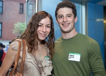 Alumni like Julia Mellon, AB '11, and Gabriel Abramowitz, BSBA '12, mingle with fellow alumni and currents students in New York. (Jennifer Weisbord, BFA '92)