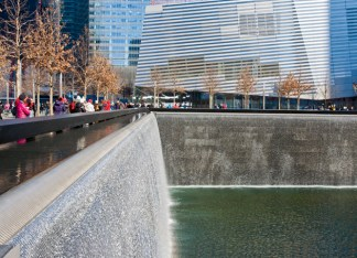 The National September 11 Memorial and Museum at the World Trade Center is a place of reverence, where visitors may honor memory as well as explore the damaging impacts of terrorism. (Jennifer Weisbord, BFA '92)