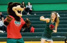 The cheer team roots for the Bears men's basketball team in its game against Principia College on Dec. 6. (Photo courtesy of Marco Quaroni)