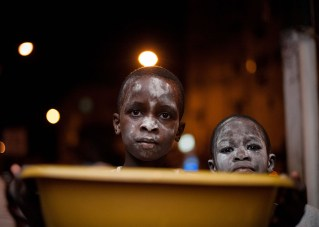 On a recent trip to Senegal, Powis took photos of Tamxarit, a holiday that has some similarities to Halloween. Children powder their faces and search for sweets.