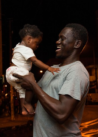 Powis captures his host-brother sharing a laugh with his young daughter. Powis studies male attitudes to maternal health in Senegal.