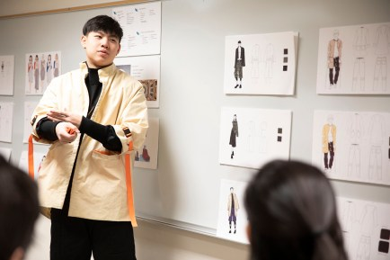 Eric Li, a junior in the Sam Fox School, presents prototype clothing made specifically for cerebral palsy patients at a review Dec. 10. The project was part of the Fashion Design Collaboration Studio, led by Mary Ruppert-Stroescu. The studio featured interdisciplinary teams of students — studying design, occupational therapy, engineering and business— working with community and industry partners to solve apparel design problems while meeting clients' aesthetic and functional needs. (Photo: Whitney Curtis/Washington University)