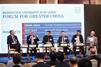 Kurt Dirks (left), vice chancellor for international, moderates a panel discussion about business strategies for the future of health care in Greater China during the forum in December. Among the panelists were Washington University alums Guy Mills, CEO of Manulife Hong Kong; Frank Jiang, CEO of CStone Pharmaceuticals; Sean Shan, president of Takeda China and area head of Takeda Greater China; and Justin Xiang, chief investment official and co-founder, Syno Capital. F. Sessions Cole, MD, from of the School of Medicine also took part in the discussion.