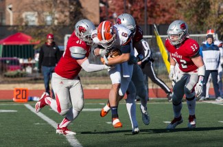 Linebacker Jake Coon and defensive back Jeff Marek tackled the Carroll University ball carrier to close the 2018 season.