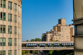 A message of gratitude is shown Oct. 1 on the skywalk over Forest Park Parkway at the Washington University Medical Campus. (Photo: Whitney Curtis/Washington University)