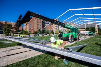 A tent is being erected on the South 40's Swamp, one of the new planned environments where students can study and spread out at a safe distance. (Photo: Joe Angeles/Washington University)