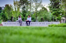 Two graduate students visit in Tisch Park before school starts. (Photo: James Byard/Washington University)