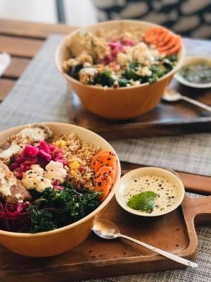 vegetarian salad bowls on cafe table