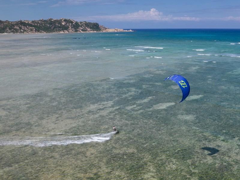 kitesurfer riding north orbit in phan rang