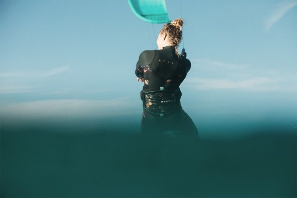 woman wearing wetsuit and mystic gem harness