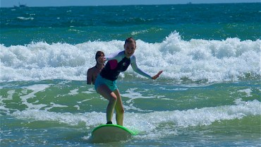 student in a surf lesson