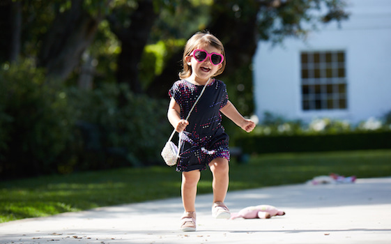 Little girl running in Stride Rite