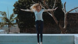 girl jumping into pool