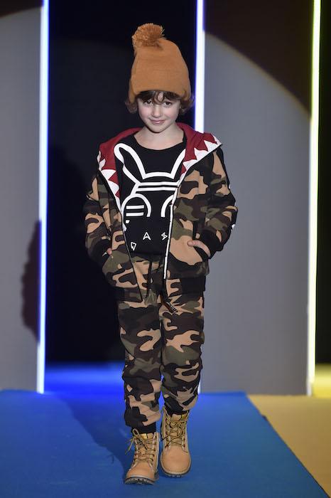 Boy in fashion show
