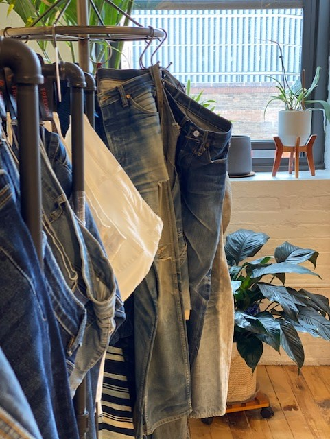 A corner view of Freedom Denim's showroom in Manhattan, which includes a rack of vintage-inspired jeans from the '30s to the '60s.