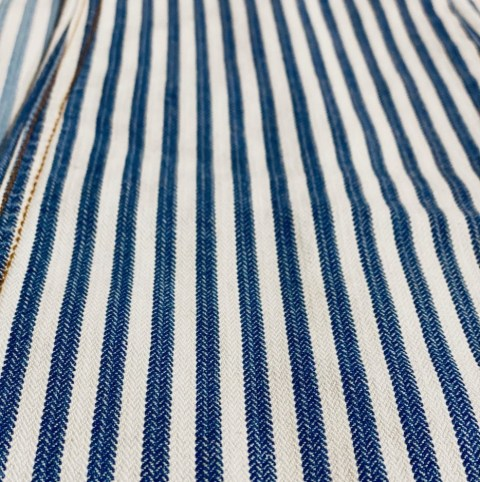This indigo-dyed Herringbone stretch fabric also runs in black, and is made with Tencel and modal fibers.