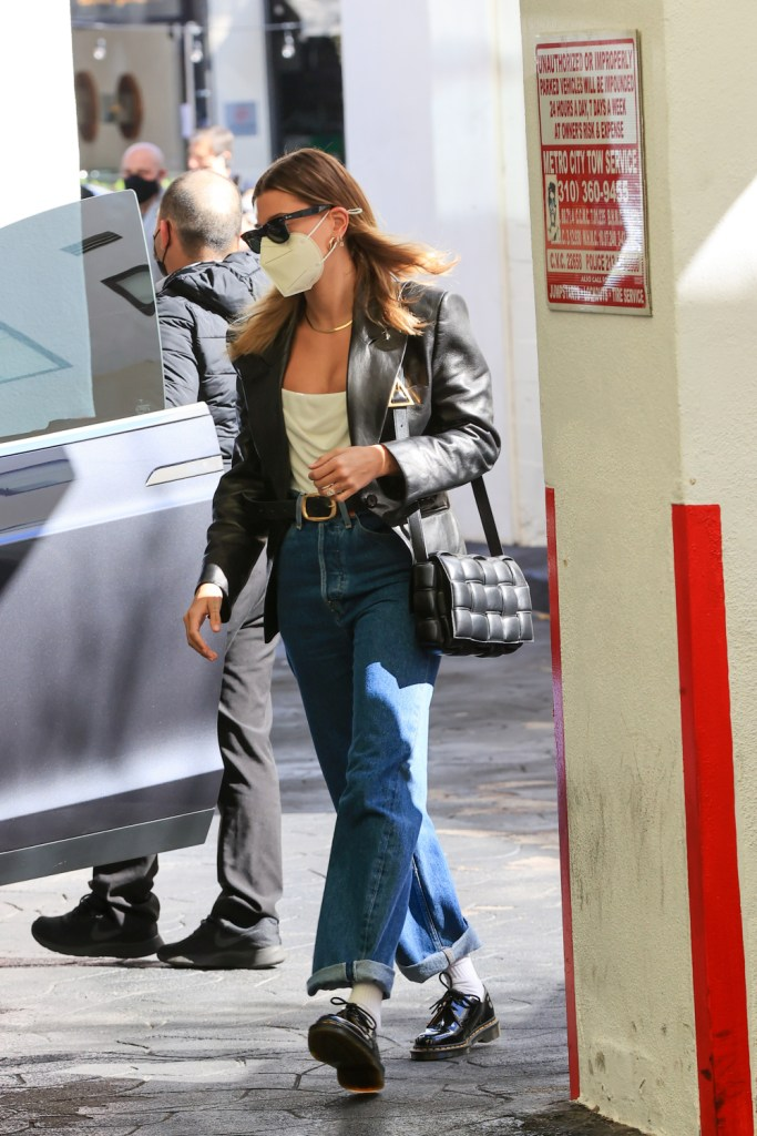 Hailey Bieber steps out in straight-fit cuffed denim.