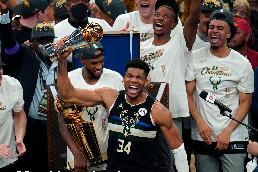 Giannis Antetokounmpo led the Milwaukee Bucks to their first NBA Finals win in half a century Tuesday night.