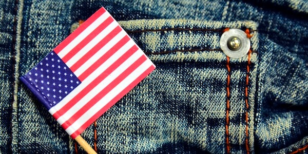 American flag in a pocket of blue jeans.