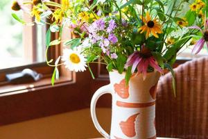 Summer flowers in a ceramic vase