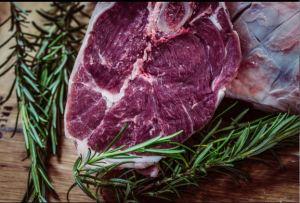 Raw steak and rosemary