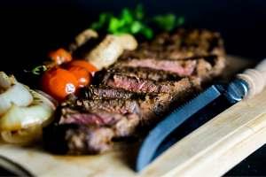 Steak on wooden serving board