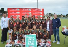 Celebrating their victory in the PE Central tournament of the SPAR Eastern Cape Schoolgirls Hockey Challenge at Westering on Wednesday are the Alexander Road team of (back, from left) Gabriela Jordaan, Lauren Gathercole, (middle, from left) Kyle Schimper (coach), Jordan Tissink, Alexandra Schenk, Asithandile Nama, Gaby Rockman, Jada Botha, Cheyenne Walton, Cassidi Ownhouse (captain) SPAR EC advertising manager Rose Shadrach, SPAR EC sponsorship and events manager Alan Stapleton, (front, from left) Aaminah Ajam, Halle Schrieff, Kiara Meyer, Zoë Maree, Alison Adams, and Bulelwa Vinjiwe. Photo: Full Stop Communications