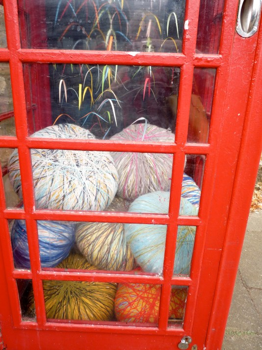 From outside to inside a red telephone box