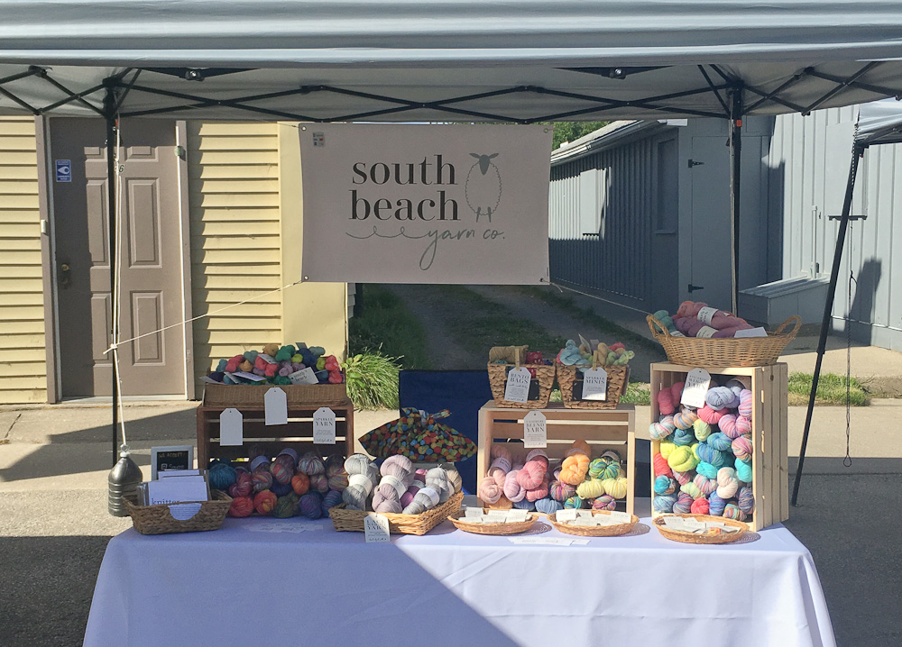 Booth of the South Beach Yarn Co at the Port Elgin Farmer's Market