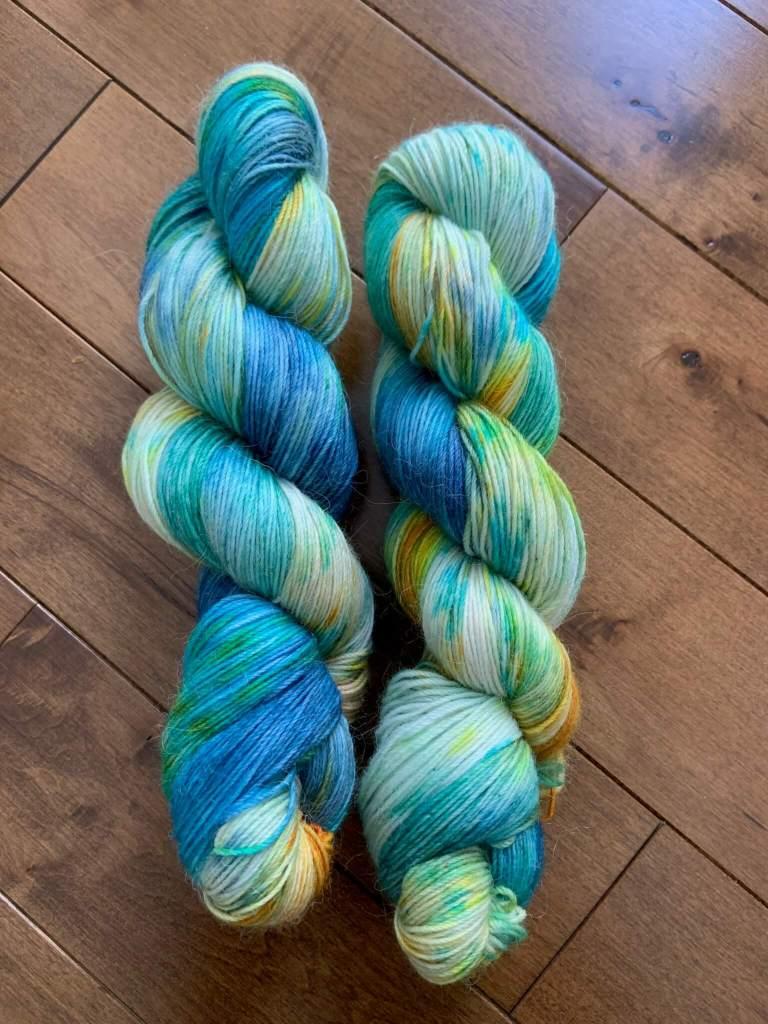 Two skeins of yarn in the colorway Mermaid