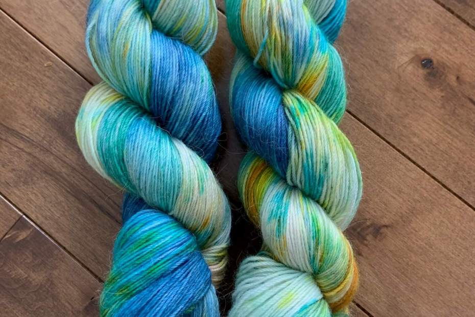 Two skeins of yarn in the colorway Mermaid
