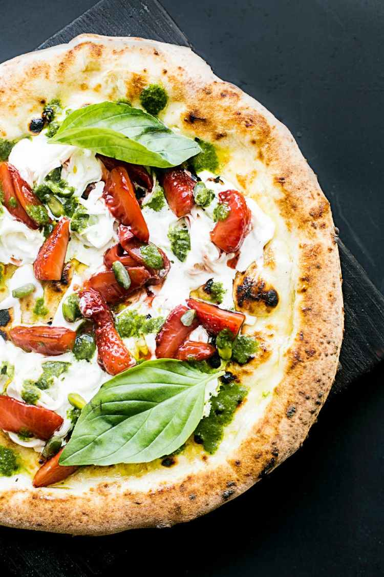 pepperoni pizza with basil leaves