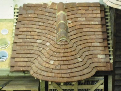 Clay plain tile swept valley and curved roof