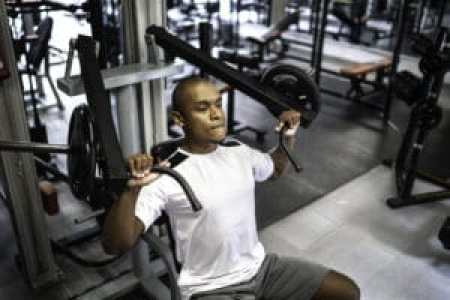 working out at a gym to maintain optimal levels of heart health