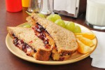 Peanut butter and jelly sandwich with fruit