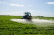 Tractor spray fertilize field pesticide chemical